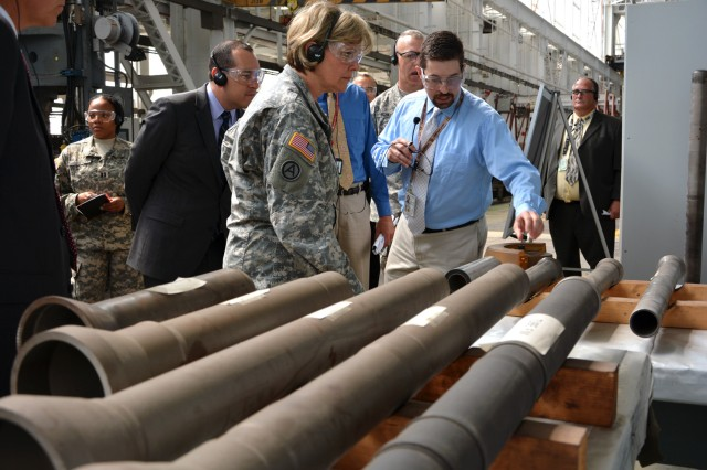 Benet Labs' Mechanical Engineer Chris Humiston explaining the mortar tube flow form process to Lt. Gen. Patricia McQuistion.  Flow form uses extreme cold versus heat to shape the tubes.