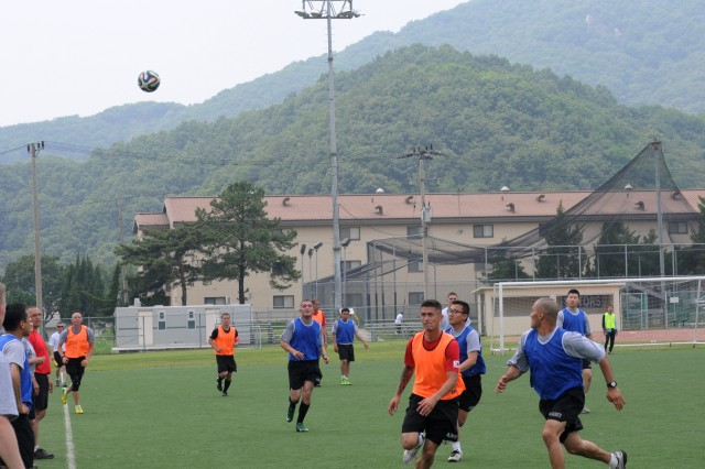 CAMP CASEY, South Korea -- Soldiers from 210th Field Artillery Brigade play soccer at Carey Field on Camp Casey, South Korea, where 1st Battalion, 38th Field Artillery Regiment, 210th FA Bde., 2nd Infantry Division went head to head with 6th Battalion, 37th Field Artillery Regiment, 210th FA Bde., 2nd Inf. Div.  during one of the many sporting events of Warrior Friendship Week.