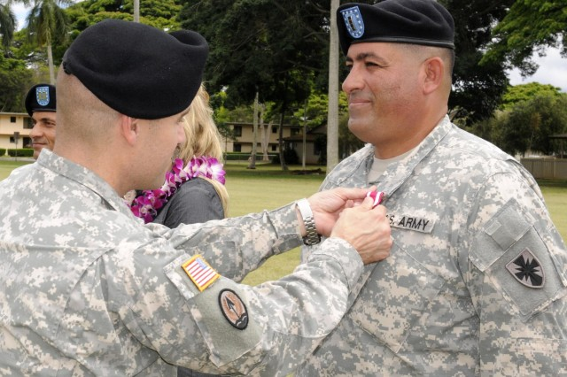 Col. Mark Jackson, commander, 8th Military Police Brigade, 8th Theater Sustainment Command, awarded Chief Warrant Officer 4 David Garcia Colon, Headquarters and Headquarters Company, 8th Special Troops Battalion, the Meritorious Service Medal for exceptionally meritorious service from October 1988 to October 2014 during the 8th TSC's quarterly retirement ceremony held at Hamilton Field, here, June 27. (Photo by Staff Sgt. Richard Sherba, 8th Military Police Brigade Public Affairs, 8th Theater Sustainment Command)