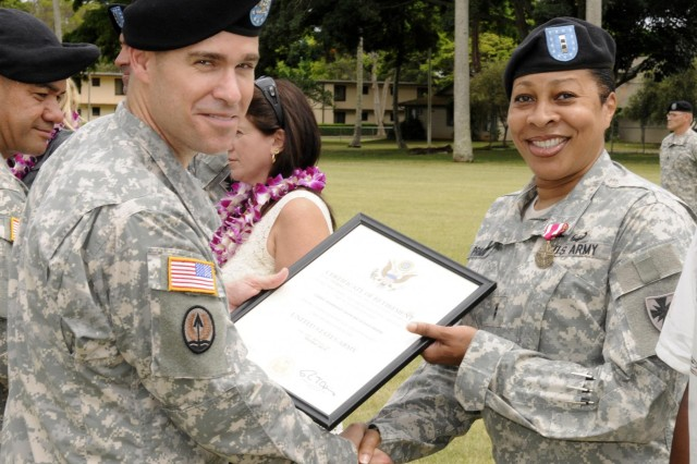 Col. Mark Jackson, commander, 8th Military Police Brigade, 8th Theater Sustainment Command, awarded Chief Warrant Officer 2 Susan Primm, Headquarters and Headquarters Company, 8th Special Troops Battalion, the Meritorious Service Medal for exceptionally meritorious service from October 1994 to October 2014 during the 8th TSC's quarterly retirement ceremony held at Hamilton Field, here, June 27. (Photo by Staff Sgt. Richard Sherba, 8th Military Police Brigade Public Affairs, 8th Theater Sustainment Command)