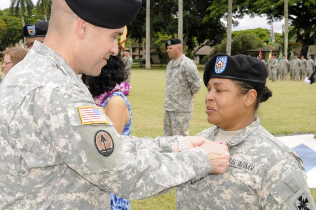 Col. Mark Jackson, commander, 8th Military Police Brigade, 8th Theater Sustainment Command, awarded Sgt. 1st Class Lachelle Johnson, Headquarters and Headquarters Company, 8th Special Troops Battalion, the Meritorious Service Medal for exceptionally meritorious service from September 1988 to September 2014 during the 8th TSC's quarterly retirement ceremony held at Hamilton Field, here, June 27. (Photo by Staff Sgt. Richard Sherba, 8th Military Police Brigade Public Affairs, 8th Theater Sustainment Command)