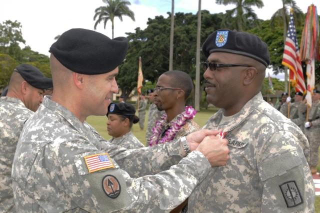 Col. Mark Jackson, commander, 8th Military Police Brigade, 8th Theater Sustainment Command, awarded Sgt. 1st Class Calvin Roney III, 57th Military Police Company, 728th MP Battalion, 8th MP Brigade, the Meritorious Service Medal for exceptionally meritorious service from January 1989 to November 2014 during the 8th TSC's quarterly retirement ceremony held at Hamilton Field, here, June 27. (Photo by Staff Sgt. Richard Sherba, 8th Military Police Brigade Public Affairs, 8th Theater Sustainment Command)