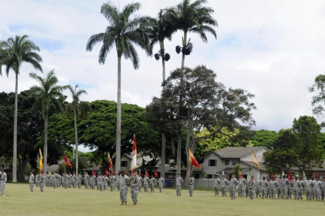 During the 8th Theater Sustainment Command's quarterly retirement ceremony held here, June 27, a formation of troops filled Hamilton Field consisting entirely of noncommissioned officers assigned to the 8th TSC, with each subordinate command represented by their unit colors and a first sergeant or command sergeant major. (Photo by Staff Sgt. Richard Sherba, 8th Military Police Brigade Public Affairs, 8th Theater Sustainment Command)
