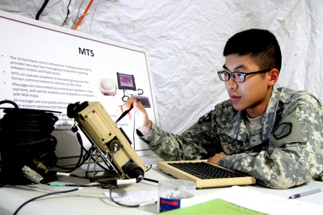 Cpl. Jung Tae-sik, Headquarters and Headquarters Detachment, 25th Transportation Battalion, 19th Expeditionary Sustainment Command, S-2 administrator specialist, operates the U.S. Army's Movement Tracking System during the crew gunnery exercise, June 25. The MTS provides two-way text messaging and position reporting between mobile and fixed assets.