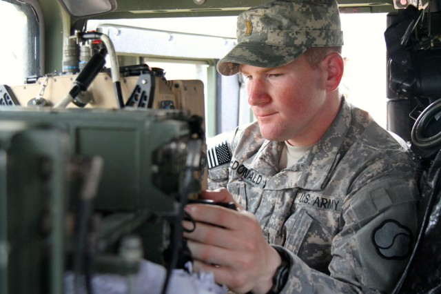 Second Lt. Zachery M. McDonald, 662nd Movement Control Team, 25th Transportation Battalion, 19th Expeditionary Sustainment Command mobility officer, operates the Movement Tracking System inside a Humvee before conducting rail operations during the crew certification exercise, June 26.
