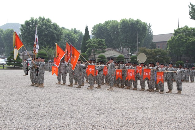 All of the 1st Signal Brigade's colors are present at the change of responsibility ceremony at USAG Yongsan's Knight Field June 25, 2014. (U.S. Army Photo by Spc. Gregory T. Summers)