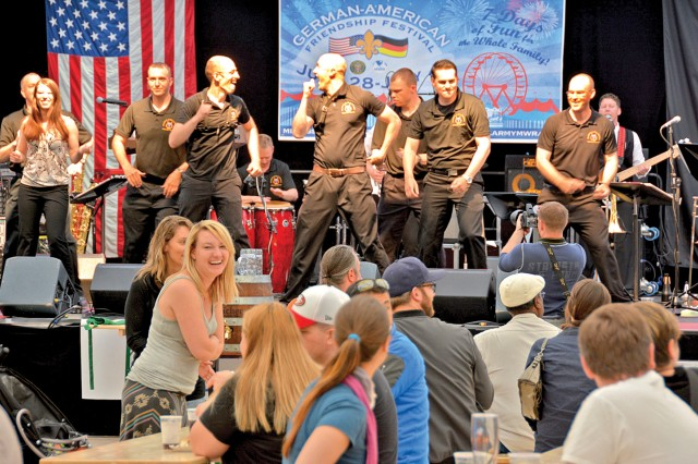 Fest-goers enjoy a performance by the U.S. Army Europe Band and Chorus the Wiesbaden German-American Friendship Festival June 28.