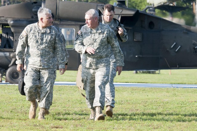 Vice Chief of Staff of the Army Gen. John F. Campbell arrives to Fort Stewart, Ga., July 1, 2014, with 3rd Infantry Division Commanding General Maj. Gen. John M. Murray, to discuss aspects of the Army's Ready and Resilient Campaign, and to hold a manpower reduction conference with senior leaders.