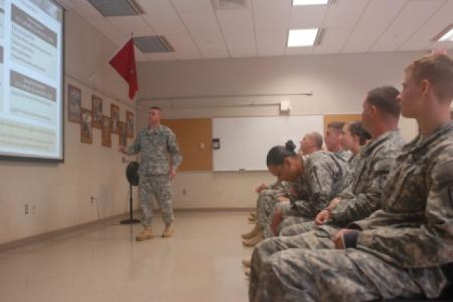 Col. Mark Jackson, the 8th Military Police Brigade commander, instructs Soldiers from the 130th Engineer Brigade, both units subordinate of the 8th Theater Sustainment Command, about Sexual Harassment/Assault Response and Prevention during a SHARP stand down day, June 27, at Schofield Barracks, Hawaii.