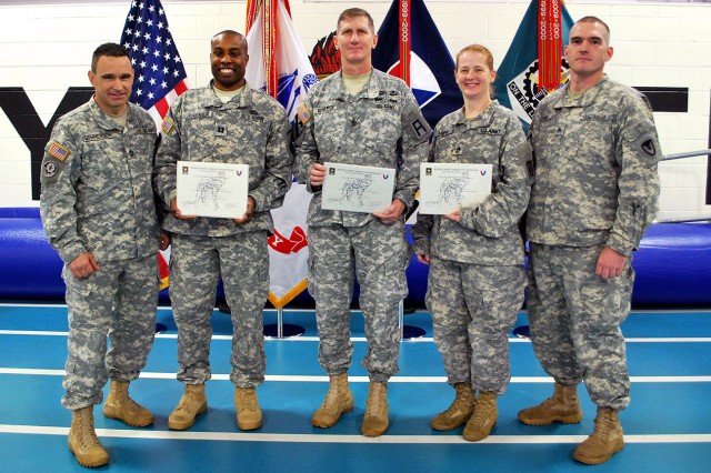 (From left to right) Sgt. 1st Class David Stephenson, tactical combatives course primary master instructor, Army Sustainment Command; Capt. Barry Farmer, unit integrator for the Distribution Management Command, ASC; Sgt. Maj. Charles Geisewite, operations sergeant major, First Army; Sgt. 1st Class Gail Amend, enlisted personnel management noncommissioned officer, First Army; Sgt. Lucas Blair, assistant combatives instructor and headquarters supply sergeant, ASC. Not pictured: Sgt. 1st Class Haven Crecelius, course honor graduate, operations training support NCO, First Army. (Photo by Dawn Marie Barnett, ASC Public Affairs)