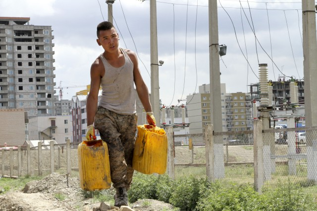 Pvt. Mankhbat Batmunkh, a service member with the Mongolian Armed Forces, carries water in order to mix cement at the water distribution site during a Khaan Quest 2014 Engineering Civic Action Program project in the 4th Khoroo district, Ulaanbaatar, Mongolia, June 24, 2014. Khaan Quest is a multinational peacekeeping exercise co-sponsored by U.S. Army, Pacific, and U.S. Marine Corps Forces, Pacific, hosted annually by the Mongolian armed forces.