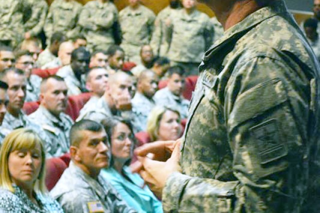 Sgt Maj. of the Army Raymond Chandler took the time to talk to Soldiers from the 12th Combat Aviation Brigade about various topics including the Sexual Harassment/Assault Response and Prevention Program, and suicide prevention, during a town hall in Katterbach, Germany, July 2, 2014. Chandler also answered questions from the Soldiers about the new AR 670-1, conditions in Iraq, and Soldiers pay.