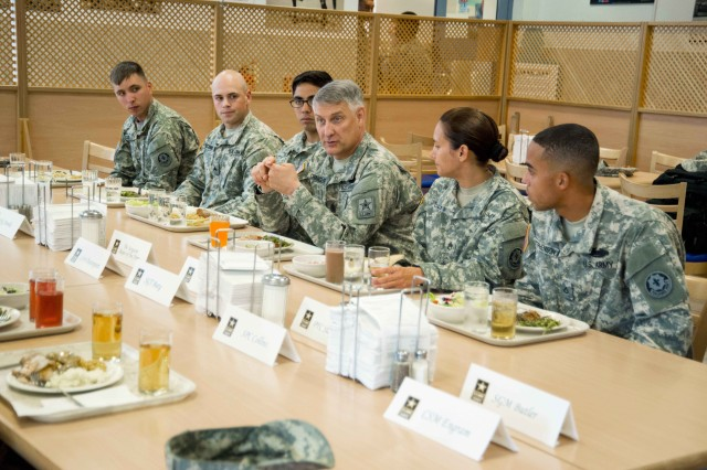 ROSE BARRACKS, Germany -- Sergeant Major of the Army Raymond F. Chandler III (middle) speaks to Troopers and leaders assigned to the 2d Cavalry Regiment July 1, 2014, at Rose Barracks, Germany. Chandler ate lunch with the group, answered questions and addressed concerns they had about issues pertaining to changes within the ranks.