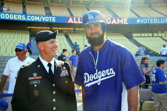 Maj. Gen. Paul Funk, 1st Infantry Division commander, spends time with Dodgers' Left Fielder Scott Van Slyke July 1 at Dodgers Stadium.