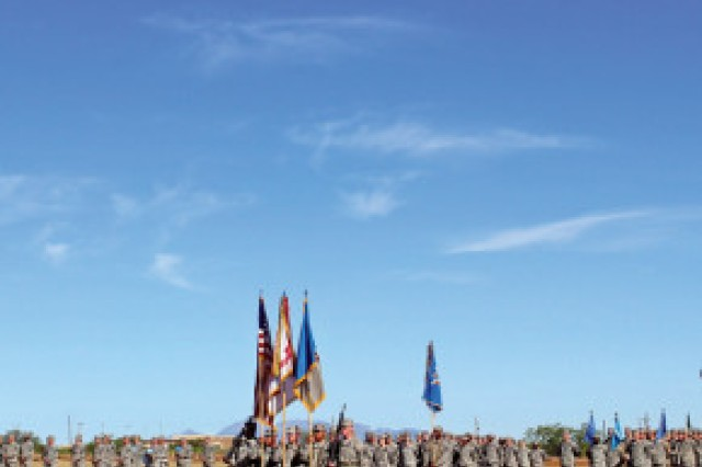 "Pictured in the foreground, from left, Maj. Gen. Robert Ashley, commanding general, United States Army Intelligence Center of Excellence and Fort Huachuca, receives the organizational guidon from Col. Richard ""Mike"" Monnard, outgoing commander, 111th Military Intelligence Brigade, June 27 on Chaffee Parade Field. Ashley then passed the guidon to Col. Kevin Wilkinson, incoming commander, before an audience of more than 100 Soldiers, Family members, Civilians and other distinguished guests."