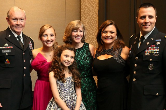 Chairman of the Joint Chiefs of Staff Gen. Martin Dempsey was on hand at the Military Children of the Year awards ceremony on April 10. Left to right: Gen. Dempsey, Kenzie Hall, Madison Hall, Mrs. Dempsey, Aerica Hall, and Capt. Jason Hall.