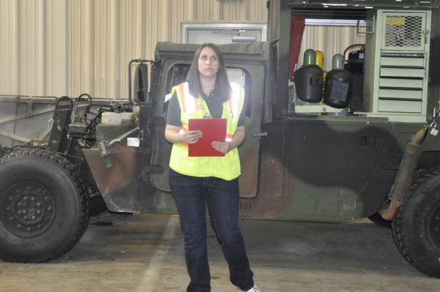 Fort Worth District energy project coordinator, Chelsey Click, inspects the D.A Carson Marine Corps Reserve Training Center maintenance bay exhaust piping for energy inefficiencies during a May 28 energy audit.