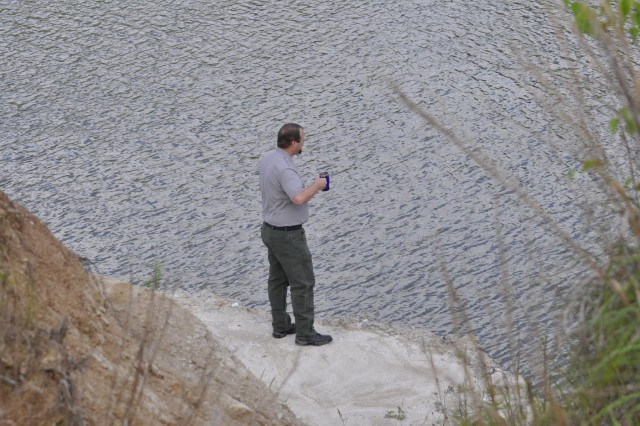 Sam Rayburn Lake Manager Bart Dearborn inspects the lake to ensure there is no oil residue remaining after completing cleanup of a non-hazardous release of insulating transformer oil that discharged April 28 in the river channel downstream of the Sam Rayburn Power Plant.