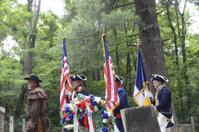 The Sons of the American Revolution Valentine Sevier Color Guard march off the G.H. Smith Cemetery, past a White Carolina pine tree, during the grave dedication ceremony for Revolutionary War Soldier Pvt. Samuel Smith, , June 28. Smith planted the pine tree in 1833, when he brought his Family from North Carolina to settle in the Clarksville, Tenn., area.