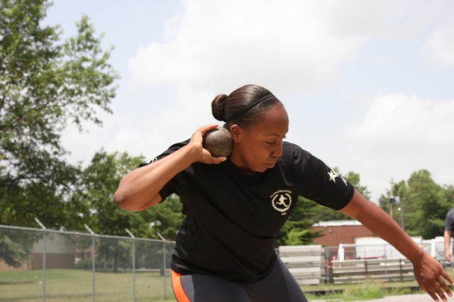 Sergeant Kadina Baldwin heaves a heavy shot put ball Tuesday at Fort Campbell's Fryar Stadium, demonstrating the winning technique she used during the Army Warrior Games trials June 15-20 at the U.S. Military Academy, West Point, New York. Baldwin took the bronze medal in shot put and gold medals in wheelchair basketball and sitting volleyball.