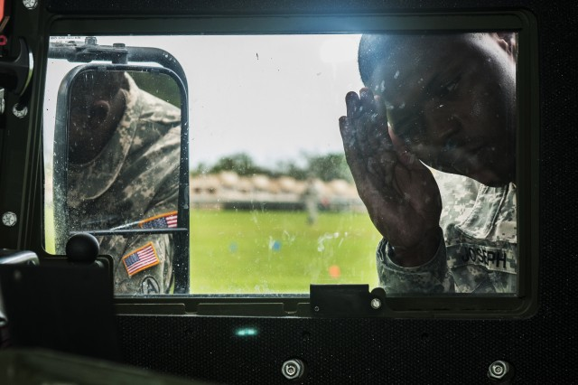 Sgt. Jerrone Joseph, medical supply specialist, 377th Theater Sustainment Command, inspects a vehicle during a recovery, collection, and evacuation mission as part a Mortuary Affairs Specialist Course practical exercise at 5th Brigade, 94th Training Division, San Juan Puerto Rico, May 29, 2014. In addition to assisting with autopsies, mortuary affairs specialists perform duties relating to deceased personnel, including recovery, collection, evacuation, and establishment of tentative identification. They also inventory, safeguard, and evacuate the effects of deceased Soldiers.