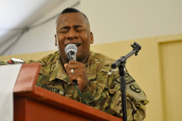 Staff Sgt. Terriance Hamilton, the property noncommissioned officer in charge for the American Contract Air Transport Cell with the 3d Sustainment Command (Expeditionary), provided the sermon for the 401st Army Materiel Command chapel June 29 at Bagram Air Field, Afghanistan. Hamilton began with a song before starting his sermon.