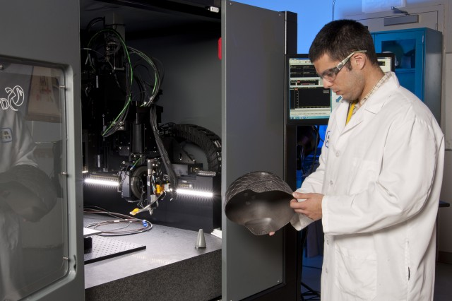 Army researchers conduct case studies to optimize the processing parameters for different material depositions using a customized 3-D printer. Researchers like Ricardo Rodriguez hope to someday print large items like a Soldier's helmet with sensing capabilities embedded in hybrid materials, a potential solution they expect to optimize Soldier capabilities while reducing weight.