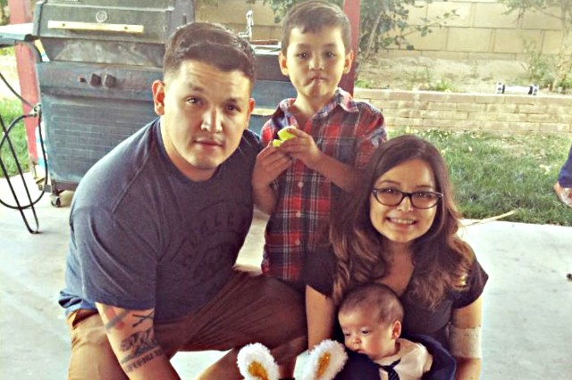 "Yesenia Ruiz-Rojo poses with her husband, stepson and ""miracle"" baby, Luke, on Easter at her family's home in California."