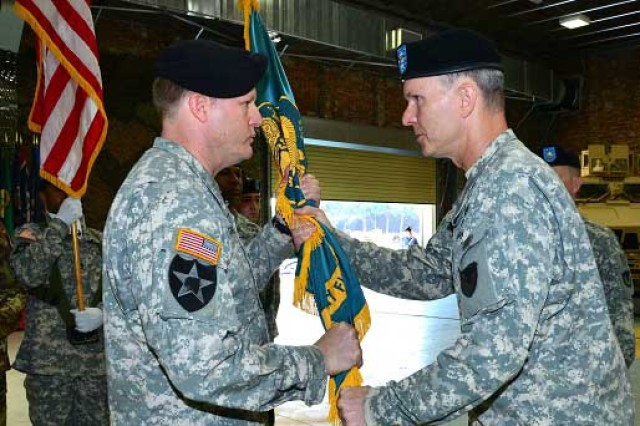 Col. Christopher Roscoe, commander, 405th Army Field Support Brigade, passes the battalion colors to Lt. Col. Joseph Greenlee, incoming battalion commander, June 27 in Livorno, Italy. (Photo by Steven Stanfill, 405th AFSB Public Affairs)