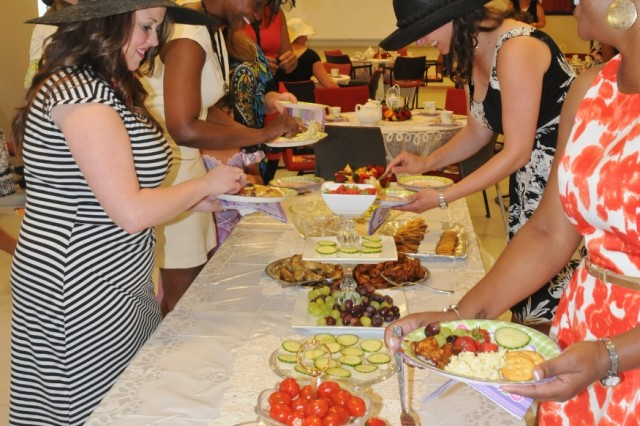 Participants at the ACS resiliency tea party enjoy a delightful array of finger foods.
