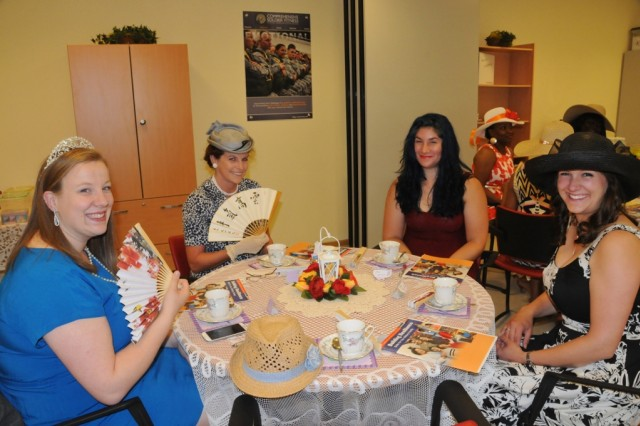 Lovely hats and fancy fans spice up the ACS resiliency tea party at Hohenfels, recently.