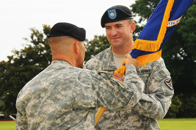 Lt. Col. John Tucker accepts the unit colors from Col. Jayson Altieri, 110th Aviation Brigade commander, during a change of command ceremony June 25 at Howze Field.