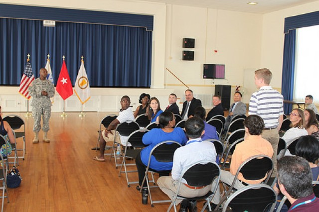 ABERDEEN PROVING GROUNDS, MD (July 7, 2014) -- Brig. Gen. Bruce T. Crawford, APG Senior Mission Commander and commanding general of U.S. Army Communications-Electronics Command greets Harford County high school students during the opening ceremony of the Real-world Internships in Science & Engineering (RISE) Intern Program.