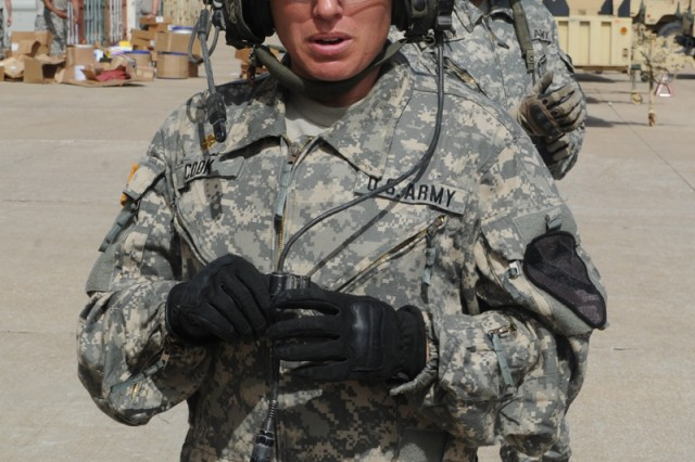 Maj. Chrissy Cook explains her role of Bradley commander as she and her crew prepare to maneuver their Bradley in the 3rd Brigade Engineer Battalion motor pool, July 7, 2014, during a media engagement at Fort Hood, Texas.