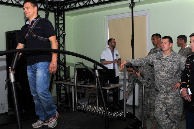 Spc. Justin Barnett (far right), a paratrooper assigned to B Troop, 91st Cavalry Regiment, 173rd Airborne Brigade, watches a live demonstration of the Amputee Care Center's Gait Real-Time Analysis Interactive Lab July 2, 2014, in Tallinn, Estonia. Barnett, a native of Gulfport, Miss., and three other paratroopers from Troop B, joined American, British and Estonian service members and leaders for the opening of the center, which will treat wounded Estonian troops, who previously had to go out of country for such care.  The six-year long project was made possible by the time, resources and expertise from Estonia, Great Britain, and the United States. Approximately 600 paratroopers from the 173rd Airborne are in Estonia, Latvia, Lithuania and Poland as part of Operation Atlantic Resolve to demonstrate America's commitment to NATO obligations and sustain interoperability with allied forces.