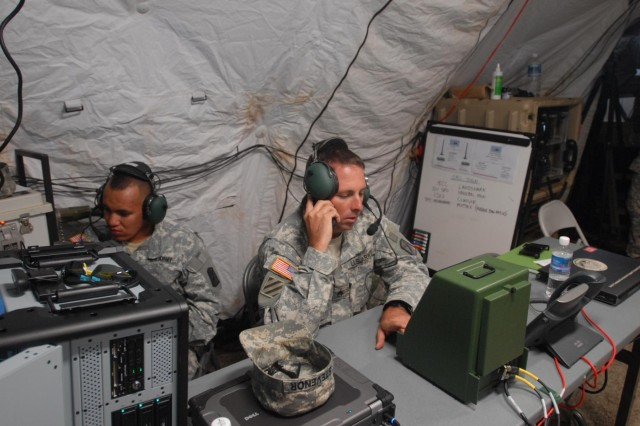 Soldiers with the 545th Transportation Harbormaster Detachment and the 73rd Signal Company set up the Harbormaster Command and Control Center at Ford Island, Joint Base Pearl Harbor-Hickam, Hawaii, July 8, 2014, to support and participate in senarios and exercises during the biennial Rim of the Pacific 2014 exercise. The HCCC is able to track and communicate with any ship and vessel entering or exiting a particular port within 10 nautical miles. A mobile and deployable system, the HCCC can be set up in less than six hours and streamlines port traffic ensuring no loss of life or cargo.