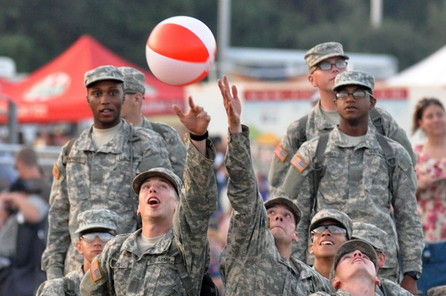 Soldiers pass a beach ball around in the hours leading up to Fort Jackson's Torchlight Tattoo ceremony and fireworks display July 4, 2014, at Hilton Field.