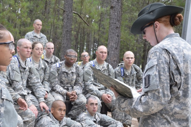Staff Sgt. Tobi Nelson, right, a drill sergeant with Company A, 2nd Battalion, 60th Infantry Regiment, reads instructions to Soldiers in Basic Combat Training at Fort Jackson, S.C., June 6, 2014. The Profession of Arms concept encourages Soldiers to think of their jobs as a profession.