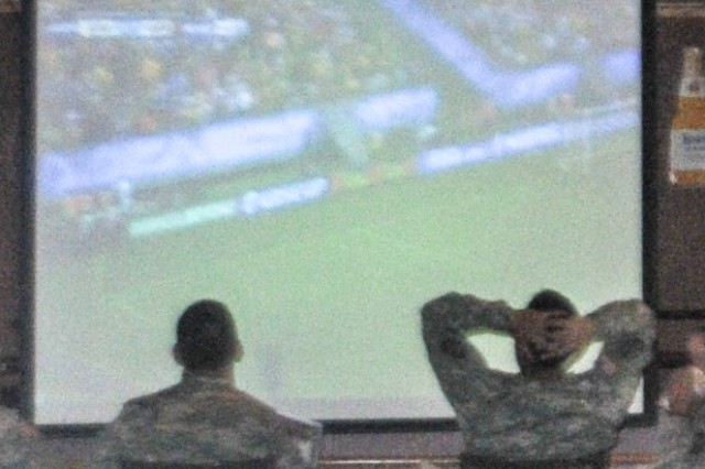 Soldiers taking an lunch break at the Impact Zone react to a near miss during team USA's match against Germany June 26. Many Soldiers from across Fort Sill took advantage of the match's convenient 11 a.m. kick-off to watch the game over lunch; restaurants across Lawton reported heavy turnouts for every U.S. game.