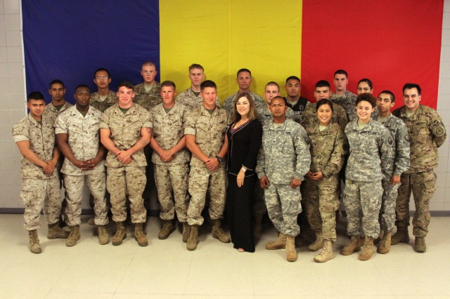 MIHAIL KOGALICEANU AIR BASE, Romania — Congresswoman Loretta Sanchez, D-Calif., stands in front of the Romanian flag with joint servicemembers July 1 at MK Air Base. Sanchez toured the transit operations at the base, which have recently expanded to take on a larger role in the movement of military personnel and equipment throughout Europe, Africa and Central America. (U.S. Army photo by Sgt. Brandon Hubbard, 21st TSC Public Affairs, USAREUR)