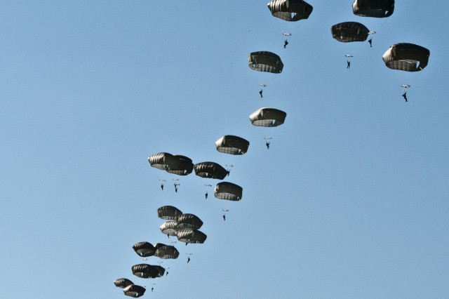 Paratroopers from 1st Squadron, 91st Cavalry Regiment, 173rd Airborne Brigade conduct an airborne operation July 8 at Nurmsi, Estonia. Approximately 600 paratroopers from the brigade are in Estonia, Latvia, Lithuania and Poland as part Operation Atlantic Resolve to demonstrate commitment to NATO obligations and sustain interoperability with allied forces. (U.S. Army Photo by Sgt. John L. Carkeet IV, 143rd Sustainment Command (Expeditionary))