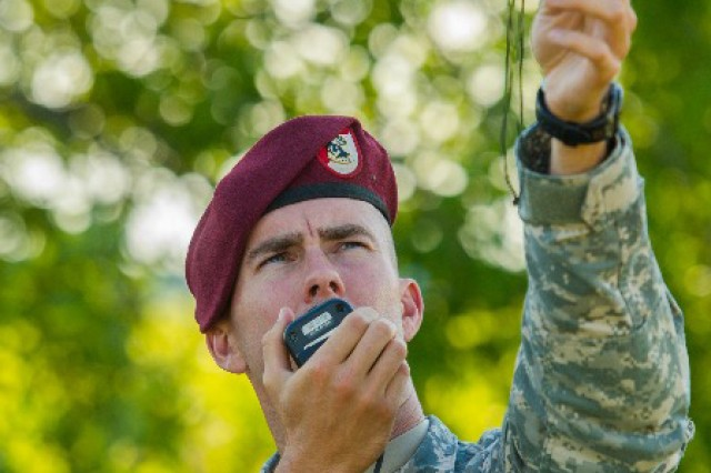 Staff Sgt. Clyde I. Tyner, a drop zone safety officer assigned to Troop A, 1st Squadron, 91st Cavalry Regiment, 173rd Airborne Brigade, relays wind speed and direction to paratroopers in an aircraft flying preparing to jump over Nurmsi, Estonia, July 8. Approximately 600 paratroopers from the brigade are in Estonia, Latvia, Lithuania and Poland as part Operation Atlantic Resolve to demonstrate commitment to NATO obligations and sustain interoperability with allied forces. (Photo by Sgt. John L. Carkeet IV, 143rd Sustainment Command (Expeditionary), U.S. Army Reserve)