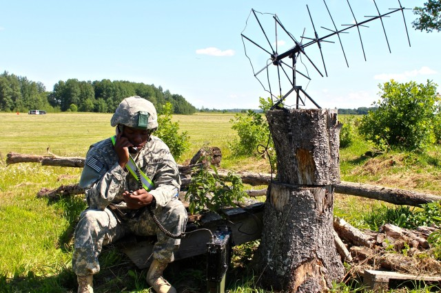 Pfc. Sherman L. Sumpter, a native of Red Springs, N.C., and a paratrooper assigned to Headquarters Troop, 1st Squadron, 91st Cavalry Regiment, 173rd Airborne Brigade, contacts his higher headquarters using a Tactical Satellite Radio, July 8, to provide communications support during an airborne operation in Nurmsi, Estonia. Approximately 600 paratroopers from the brigade are in Estonia, Latvia, Lithuania and Poland as part Operation Atlantic Resolve to demonstrate commitment to NATO obligations and sustain interoperability with allied forces. (Photo by Sgt. John L. Carkeet IV, 143rd Sustainment Command (Expeditionary), U.S. Army Reserve)