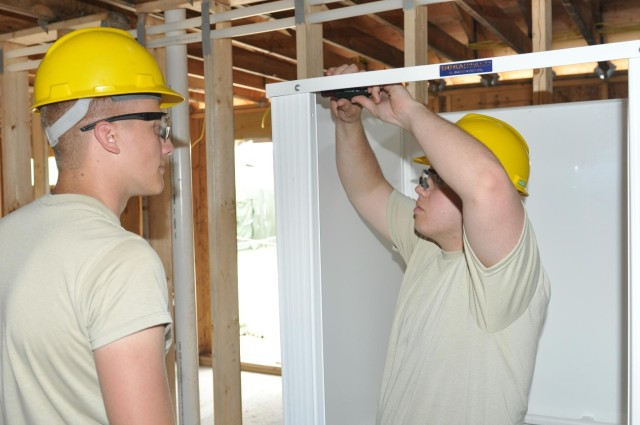 Army engineers construct shower facility