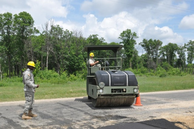 Army engineers pave training convoy road