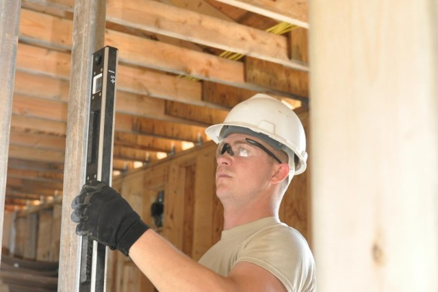 Sgt. David Hugh, a plumber and combat engineer from the 327th Engineer Company, assists in building a shower facility to be used by service members training at Forward Operating Base Liberty at Fort McCoy, Wis., as part of their annual training requirement allowing them to be technically proficient in their jobs that include electricians, plumbers, wood workers and other specialties.