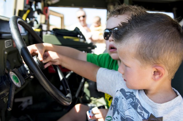 Greyson Neidetcher (front), 3, of La Grange, Illinois, and his friend Henry Scheri, 3, of Willowbrook, beep the horn of an Army Reserve Humvee belonging to the 416th Theater Engineer Command during the Touch a Truck community event hosted by the Village of Willowbrook, Parks and Recreation Department, July 11. An estimated 300 children visited and interacted with various trucks on display. (U.S. Army photo by Sgt. 1st Class Michel Sauret)
