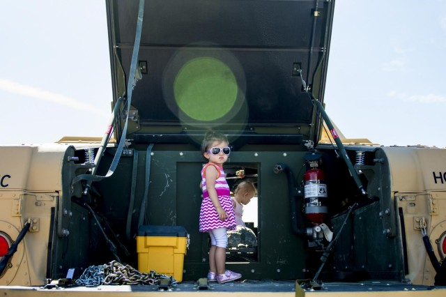 Harper Allen, 2, of Downers Grove, Illinois, stands on the back of an Army Reserve Humvee belonging to the 416th Theater Engineer Command during the Touch a Truck community event hosted by the Village of Willowbrook, Parks and Recreation Department, July 11. An estimated 300 children visited and interacted with various trucks on display. (U.S. Army photo by Sgt. 1st Class Michel Sauret)