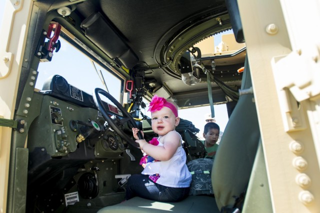 Annabelle Sheehan, 1 year old, of Willowbrook, Ill., sits in the driver's seat of an Army Reserve Humvee belonging to the 416th Theater Engineer Command during the Touch a Truck community event hosted by the Village of Willowbrook, Parks and Recreation Department, July 11. An estimated 300 children visited and interacted with various trucks on display. (U.S. Army photo by Sgt. 1st Class Michel Sauret)