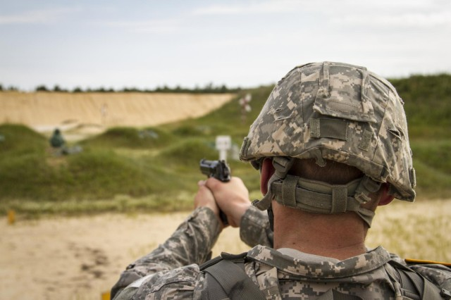 Spc. Keegan Carlson, a civil affairs specialist from Colorado Springs, Colo., with the 440th Civil Affairs Battalion, shoots at the 9 mm qualification range during the 2014 Army Reserve Best Warrior Competition at Joint Base McGuire-Dix-Lakehurst, N.J., June 23. (U.S. Army photo by Sgt. 1st Class Ryan C. Matson)